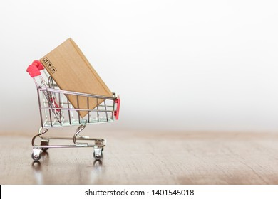Shopping cart with carboard box