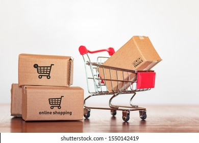 Shopping cart with cartons on wooden table