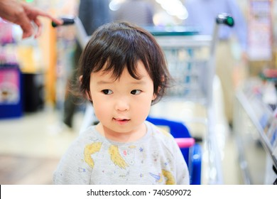 Shopping cart and child