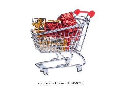 shopping cart with christmas gifts isolated on white background