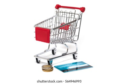 Shopping cart with credit card isolated on white
