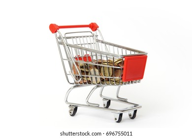 Shopping cart with euro coins isolated on white background