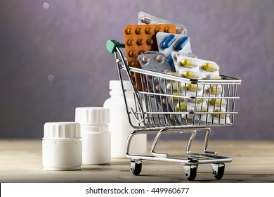 Shopping cart filled with blister packs of pills