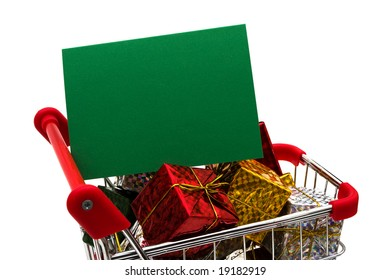 Shopping cart filled with presents and blank gift tag on white background, Christmas shopping