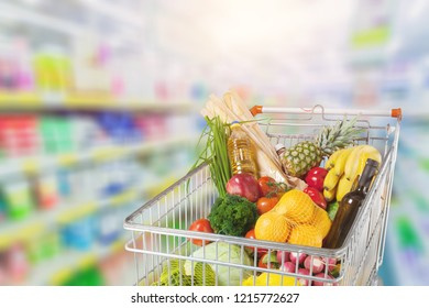 Shopping cart filled with various groceries