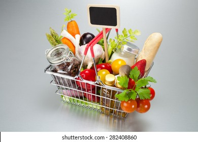 Shopping cart with food and marker prices