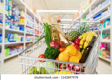 Shopping cart full of food in the supermarket