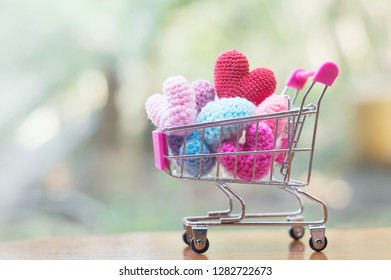 A shopping cart full of heart shape for Valentine's day or Wedding concept