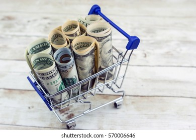 Shopping cart full of money (USD Dollar). Multi-currency basket, business, finance, economy concept.