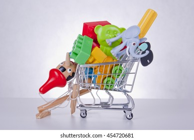 Shopping cart full of toys. Concept.