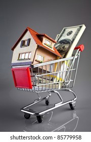 shopping cart and house on a grey background