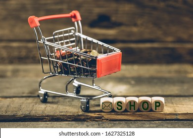 Shopping cart with Shopping icon. Background of old wood