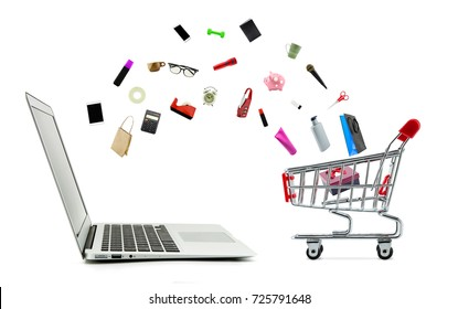 2eb47916269 Shopping cart and laptop computer with products isolated on white background
