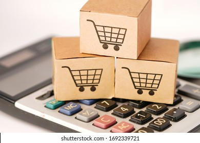 Shopping cart logo on box on calculator: Banking Account, Investment Analytic research data economy, trading, Business import export online company concept.