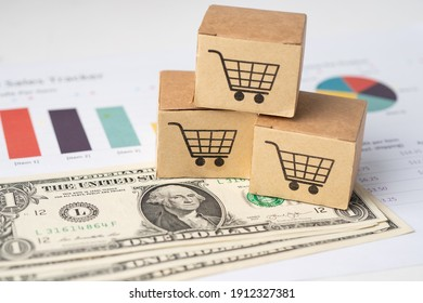 Shopping cart logo on box with US dollar banknotes and graph, Banking Account, Investment Analytic research data economy, trading, Business import export online company concept.