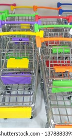 Shopping cart are minimize for model,show,keep miscellaneous items.They are on shelf,make to iron and colorful plastic to handdle.