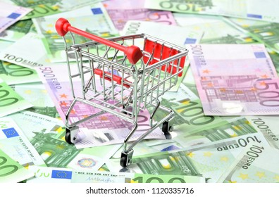 Shopping cart on euro banknotes money - finance purchase concept