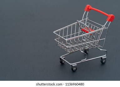 Shopping cart on gray background