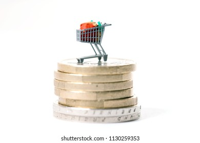 Shopping cart on a money stack