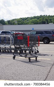 Shopping cart on a parking lot with cars