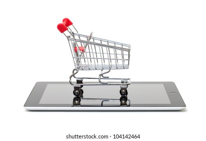Shopping Cart over a Tablet PC on white background