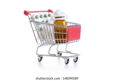 Shopping cart with pills and medicine isolated on white