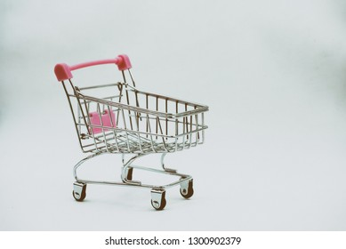 The shopping cart put on white background