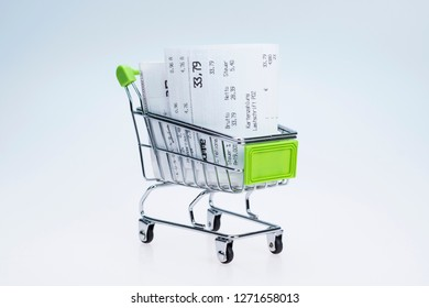Shopping cart with receipt , concept for grocery expenses and consumerism