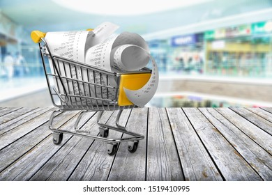 Shopping cart with receipts on white