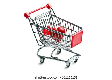 shopping cart with stone heart on white background