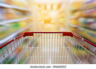 Shopping cart with Supermarket or convenience store Aisle and Shelves in blurry for background