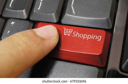 Shopping cart symbol button on computer keyboard with finger, Online shopping, Business purchase concept