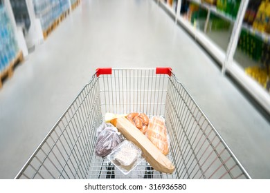 Shopping cart, trolley in a big supermarket with no people