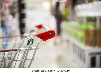 Shopping cart or trolley on department store bokeh background