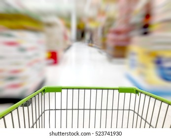 Shopping Cart View in Supermarket Aisle rice Juice canned fruits and Shelves with customer defocus background
