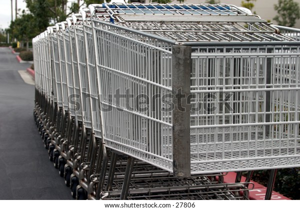 Shopping carts lined up in a parking lot