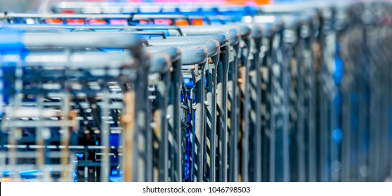 Shopping carts lined up together close up with bokeh- Conceptual photography.