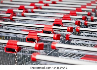 Shopping carts locked with a chain, full frame, close-up