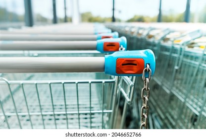 Shopping carts of a supermarket in a row, close up