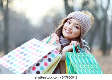 A shopping caucasian woman carrying shopping bags