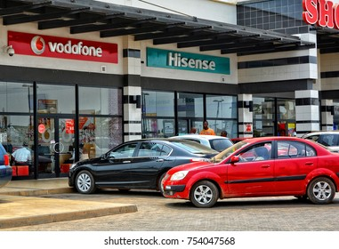 Shopping center and cars. Vodafone office. Vehicles in a parking lot. Market in Ghana, Accra -January20,2017