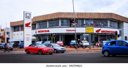 Shopping center selling modern cars. Honda salon in Centurion. Road with cars and motorcycles. Development of car sales and rental service in South Africa. Centurion, South Africa -  January 6, 2014