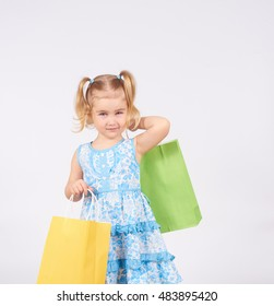 Shopping child. little girl holding shopping bags. Isolated on white background