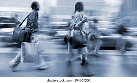 shopping in the city in motion blur and blue tonality