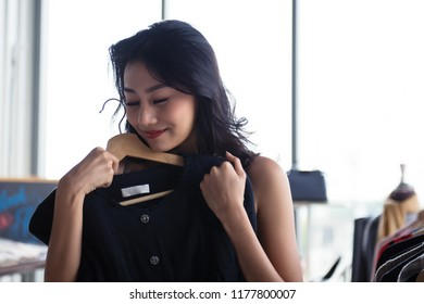 Shopping cloths and shoes is What a girls like to do the most. They loved to spend their time with new things that they needed. No matter how much cloths and shoes got before. Girl choosing cloth.