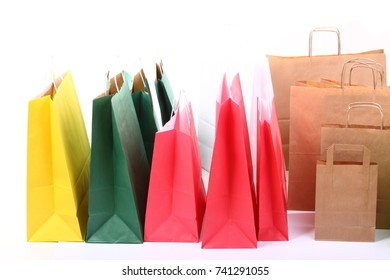 Shopping colorful gift bags isolated on white background