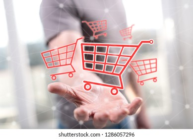 Shopping concept above the hand of a man in background