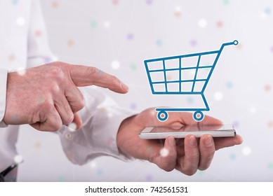 Shopping concept above a smartphone held by a man