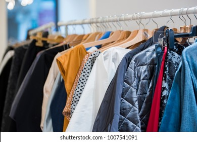 shopping concept - women clothes on hangers