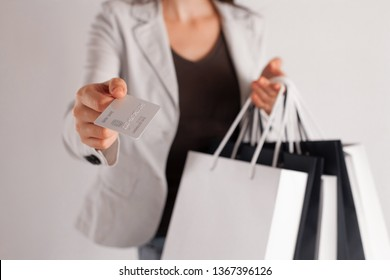 Shopping with credit card. Store sale. Woman with bags at checkout purchasing with plastic money